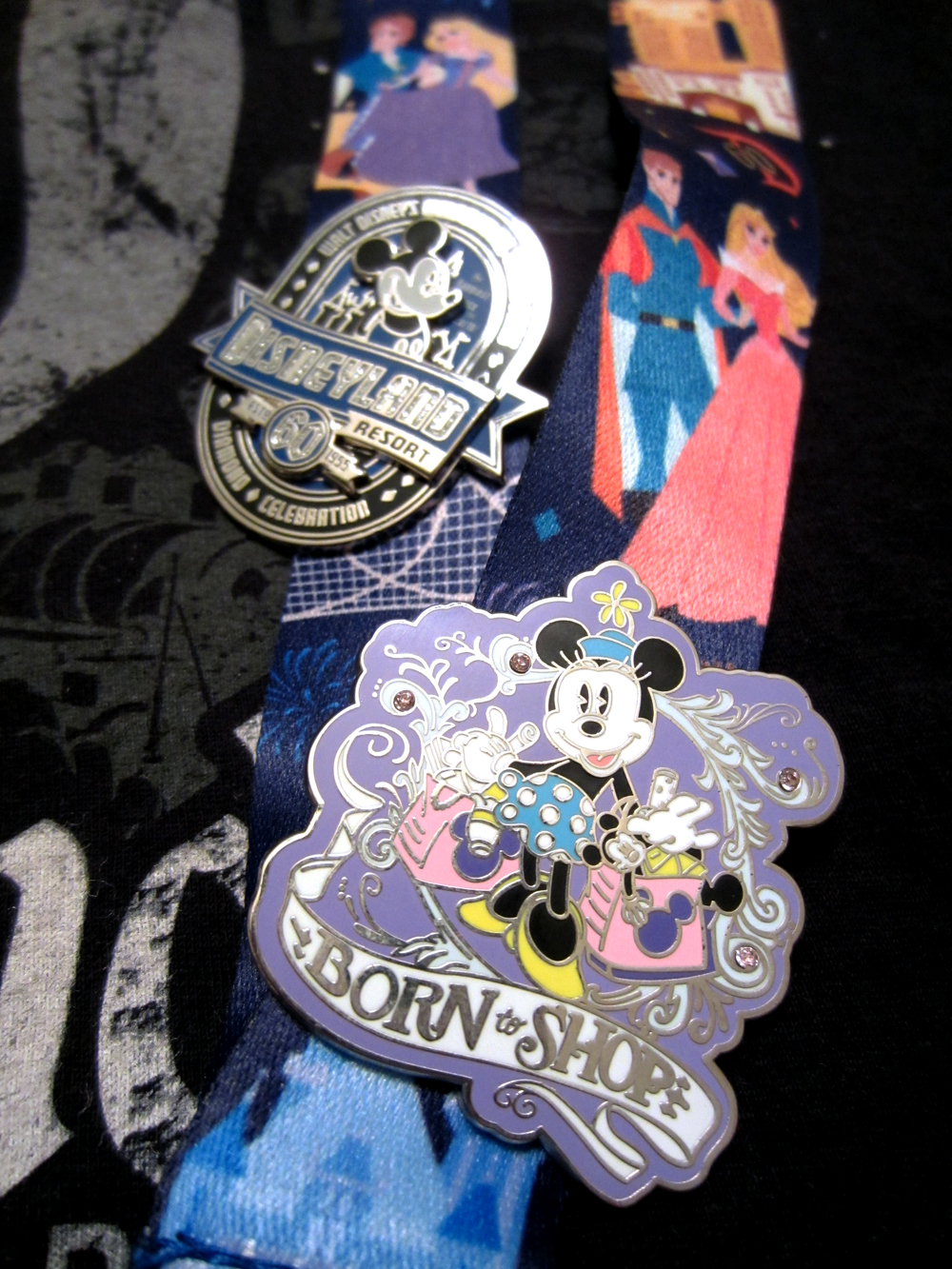 Of course I knew I couldn't leave without getting some new pins! And I really love the 60th Anniversary lanyard they designed. It has all of my favorite characters and attractions on it!