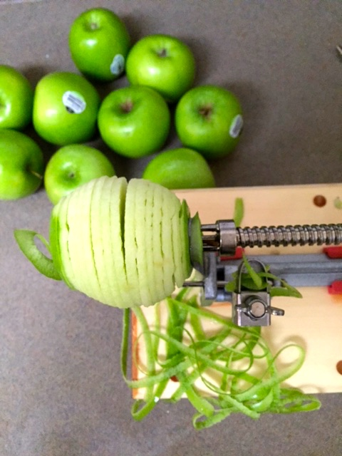 I start by coring, peeling, and slicing 5 lbs of Granny Smith apples. I love using  Pampered Chef's Apple Peeler Corer & Slicer.  It saves a ton of time, so you can start enjoying your pie sooner!