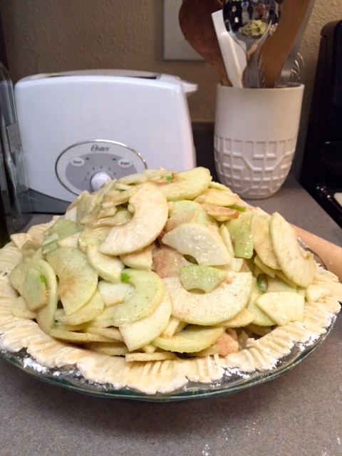 Now you can pile on those gorgeous apple slices.This is called the Mile High Apple pie for a reason, so don't be shy and stack em up nice and high!