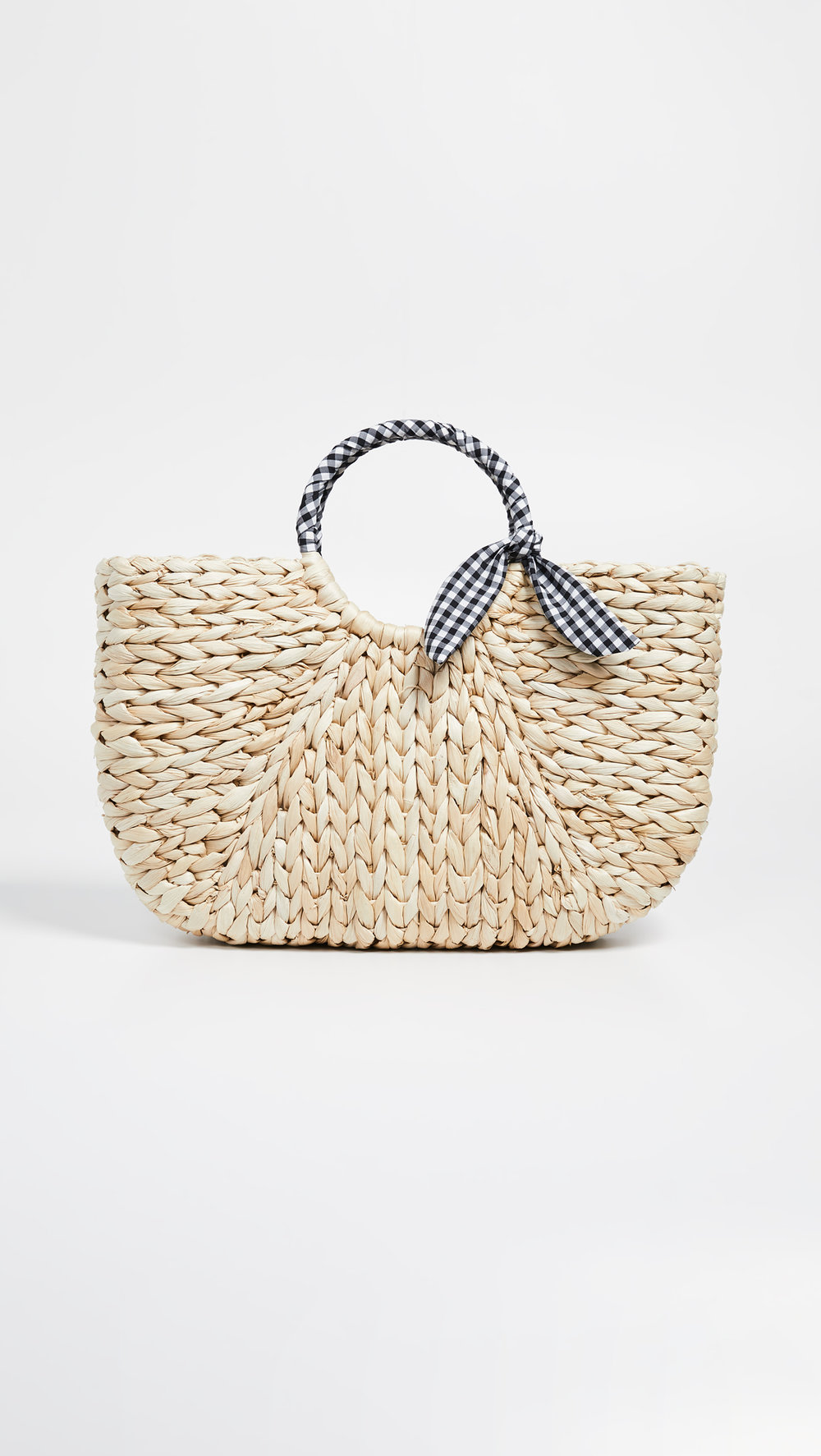A straw tote - If you're just dipping your toes in the gingham pool, this bag is a great place to start. The pattern just wrapped around the handle lets the bag shine without looking too busy or overwhelming!