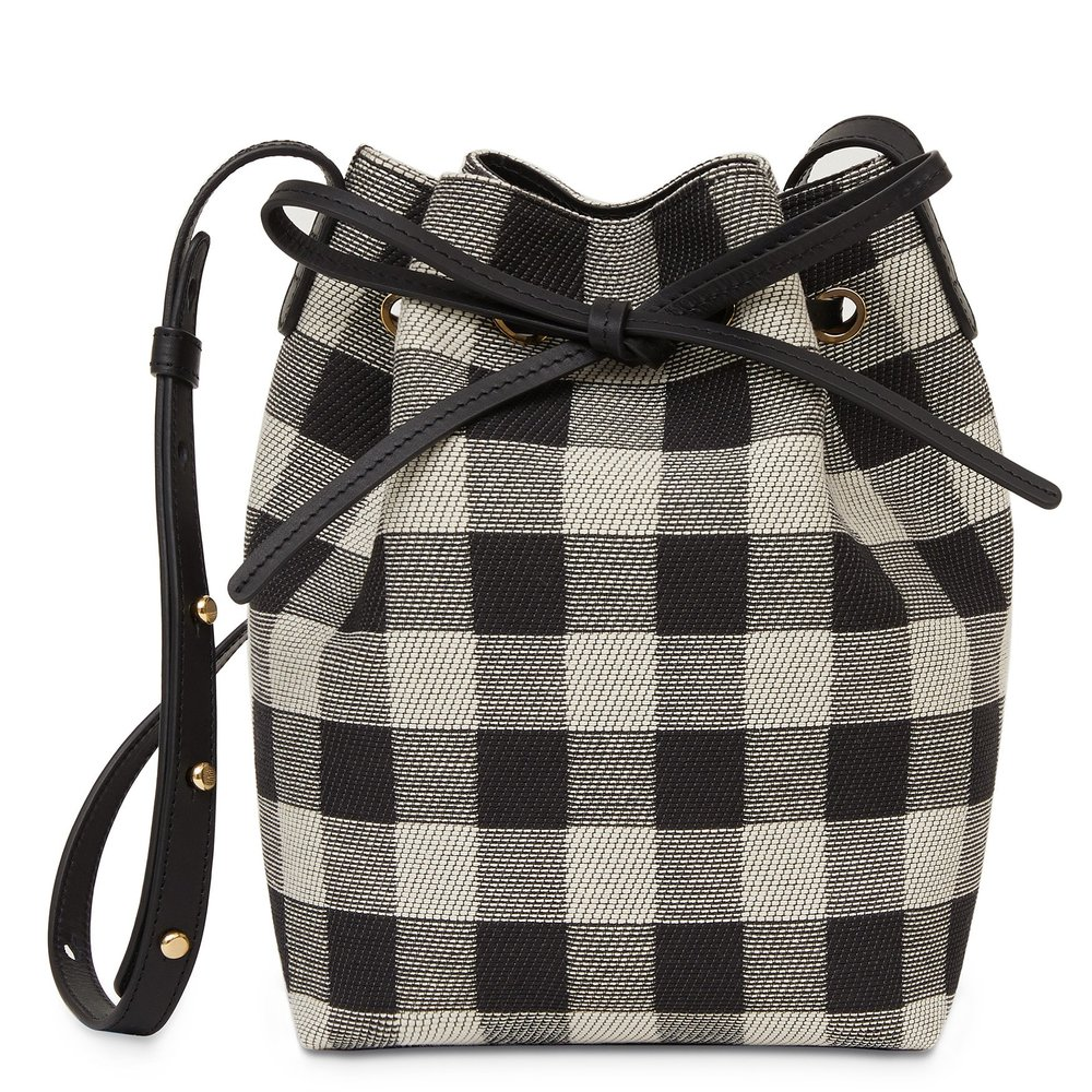 A mini bucket bag - Made from Italian cotton canvas, this lightweight bag will hold all of your spring essentials and then some. The adjustable strap provides added versatility so you can sport it as a crossbody or shoulder bag!
