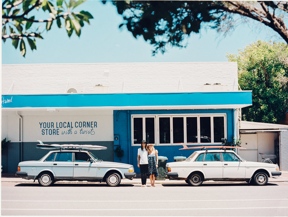 Jake and Annie and their cool cars Vera & Valley, 1992 and 1982 Volvos at the Kirkwood Corner Store after a morning surf down at Cottesloe.