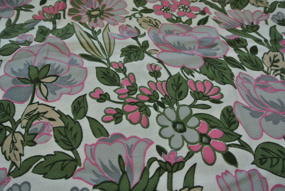 We're in love with the vivid greens and pink accents of this massive stretch of fabric.