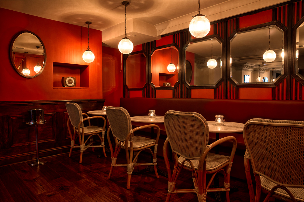 Parisian Quarter A semi-private area with a capacity of up to 25 guests, this beautiful space sits within 68, our Wine Bar and boasts intimate lighting with a mixture of seated and standing options.
