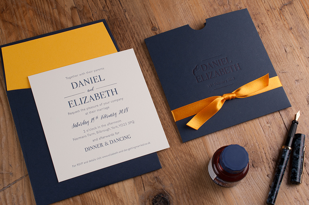 Milton Invitation Imperial Blue Pocket • Pure White Insert • Mandarin Ribbon • Navy Ink