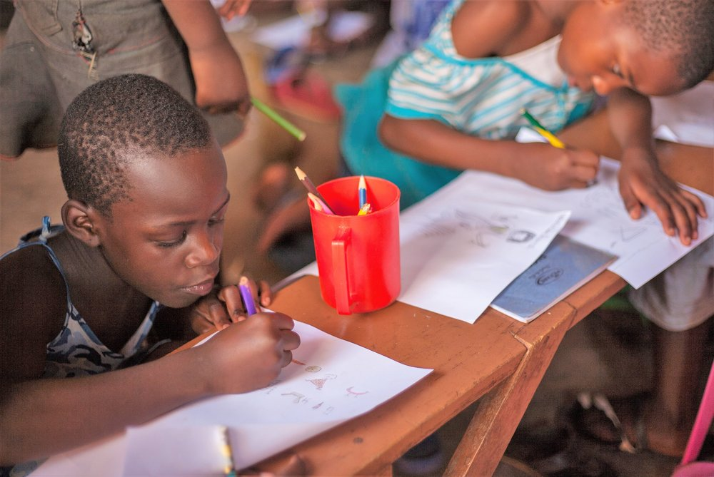 Children learning at Kids Club Kampala's Encouraging Education project