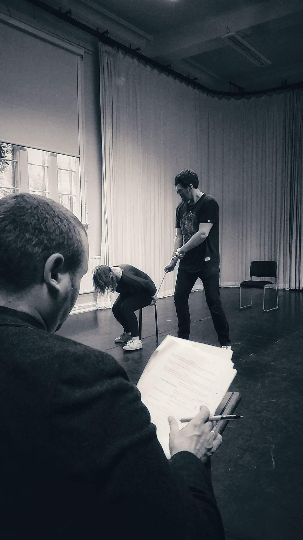 Playwright and Artistic Director Paul tweaks the script whist actors Jamie and Chloe create the 'Rotational Chair'.