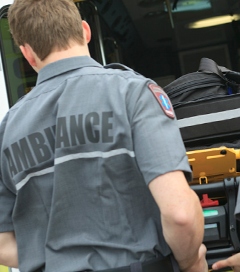 paramedic-employee-with-ambulance-in-the-background-s.jpg