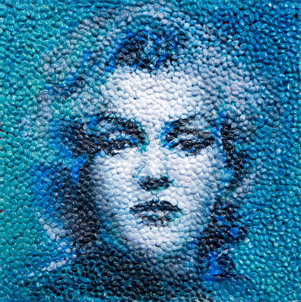 Marilyn Monroe<br>oil & popcorn kernels on wood<br>12 x 12 inches