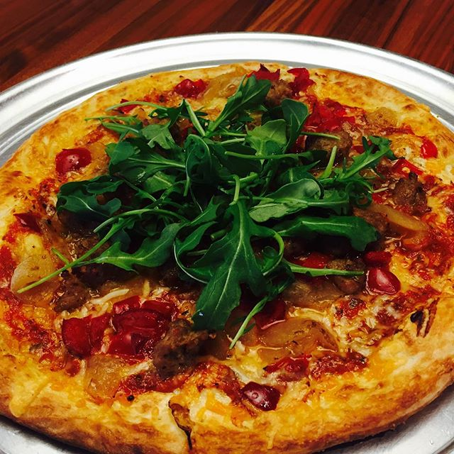 The Spicy Sicilian Pizza has arrived: hand-made arrabbiata pesto and bold garlic butter are balanced with sweet Italian sausage, peppadews and caramelized onions. Top it off with arugula and you have a perfectly spicy and peppery pizza that satisfies your cravings without going over the top. #pizza #spicy