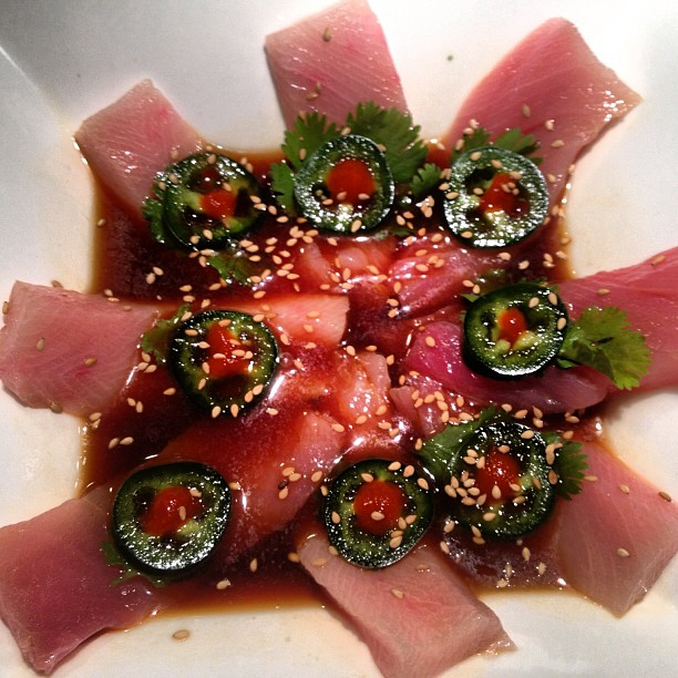 Jalapeño yellowtail sashimi with cilantro and spicy ponzu sauce, yum! #mikimotosushi #mikimotosushinola #yellowtail #sashimi #jalapeno #spicy