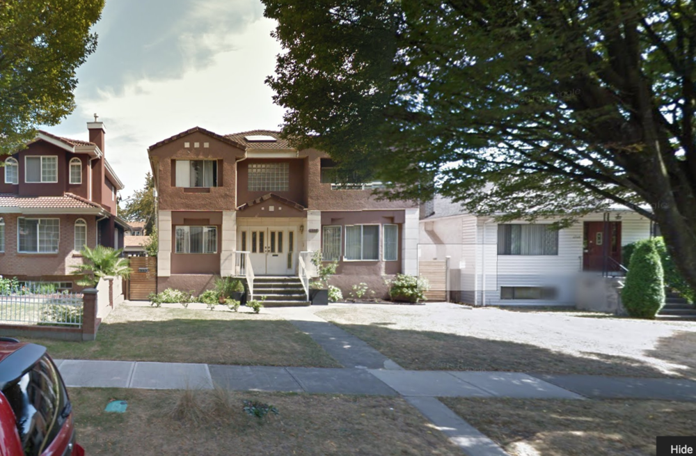 This is the same property as the photo above.  The large, and largely formal, front yard isn't allowed to contribute any functionality to the 3 dwellings on the site. Photo: Google