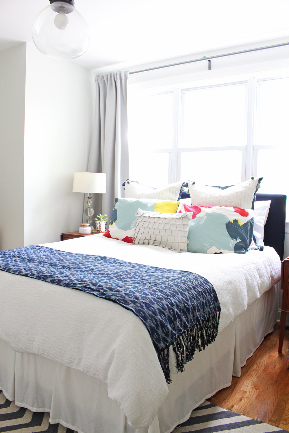 Yes, you can put beds in front of windows! This post tells you how you can pull it off well in your bedroom.