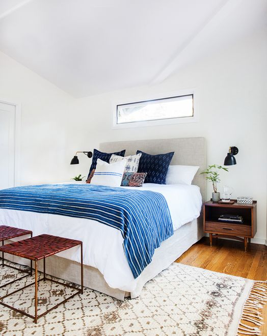 Get the look of this bright and airy, California eclectic bedroom. The mid-century modern and bohemian styles play together beautifully in this bedroom from Amber Interiors.