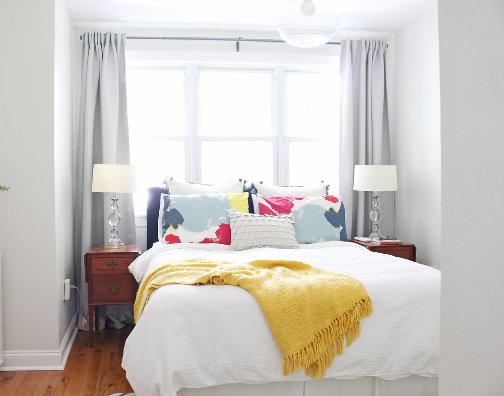 An interior designer's modern minimal bedroom with an eclectic collection of family heirlooms, DIYs, and Target finds.