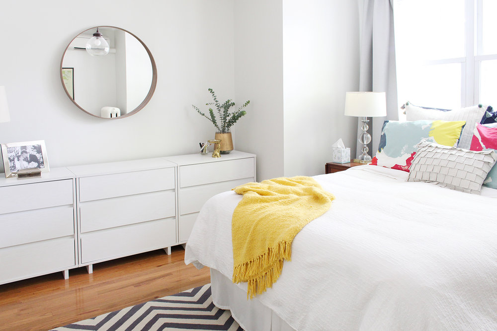 A designer's modern eclectic bedroom in a Philadelphia row house.