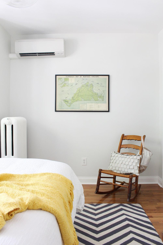 An interior designer's modern eclectic master bedroom.he T
