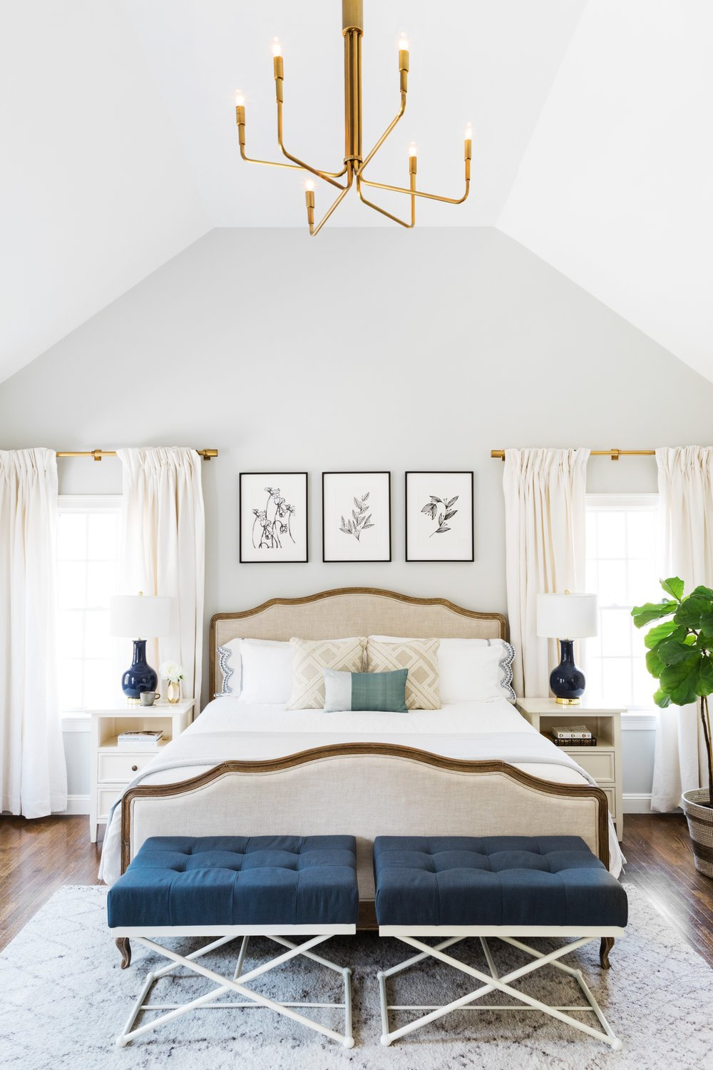 How to decorate around a bed. One option: hang art centered on the wall above the headboard. (Design: Oh, I Design) // traditional bedroom, neutral bedroom, upholstered bed