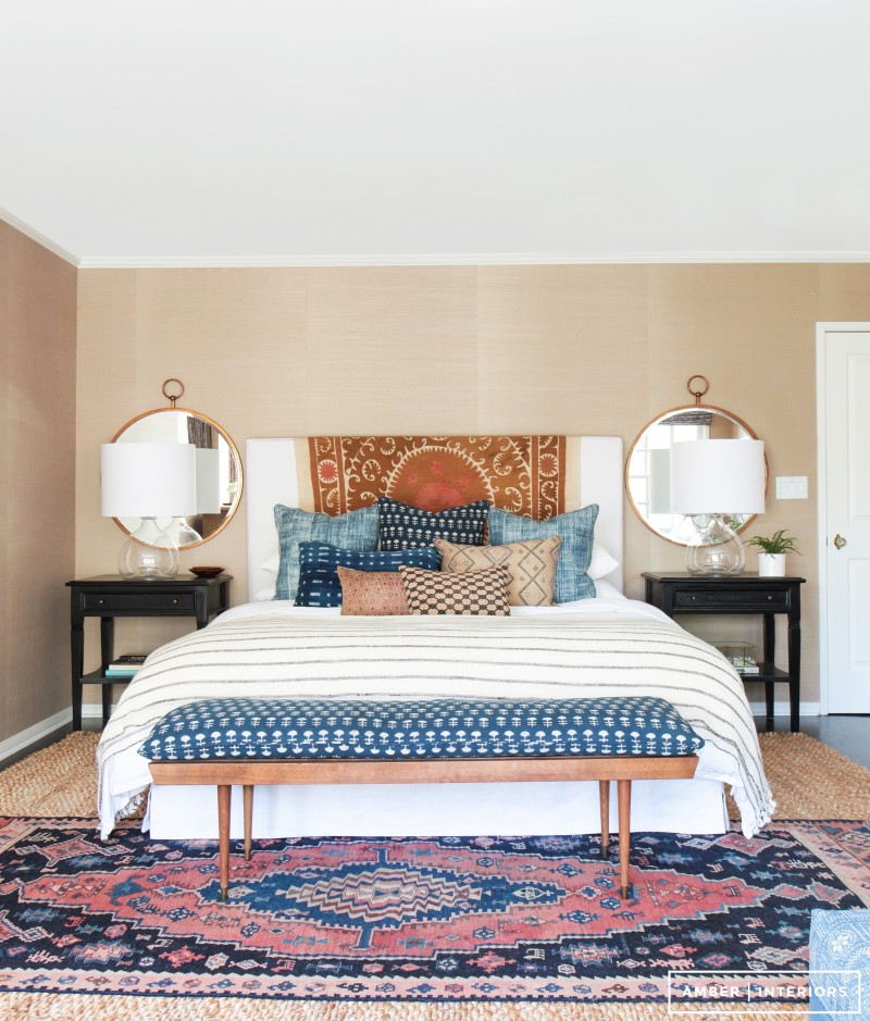 How to decorate around a bed. Option: add round mirrors on either side above nightstands. (Design: Amber Interiors) // bohemian bedroom, mid-century boho bedroom, colorful bedroom, california style bedroom
