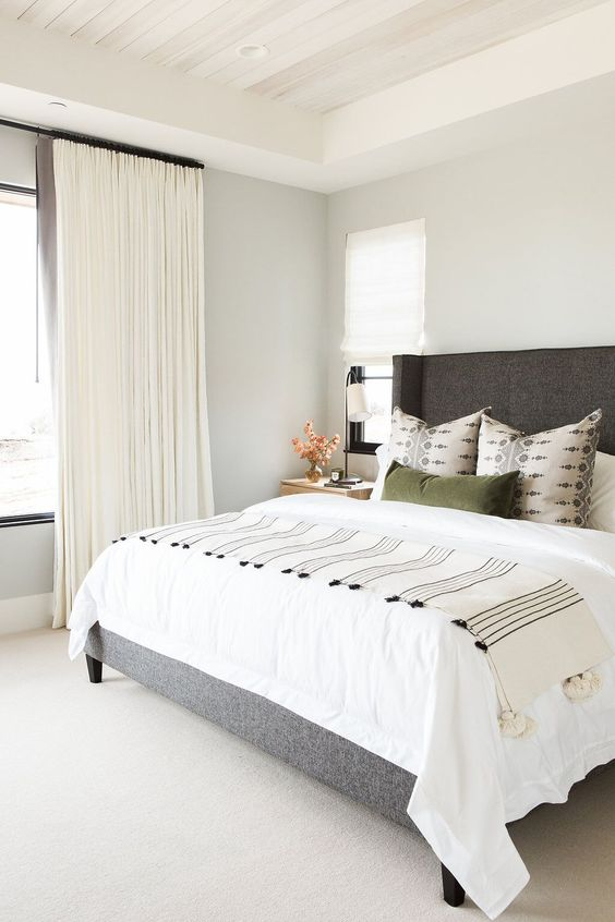 How to decorate around a bed. Option: leave the walls empty! (Design: Studio McGee) // gray and green bedroom, neutral bedroom, traditional modern bedroom, studio mcgee bedroom