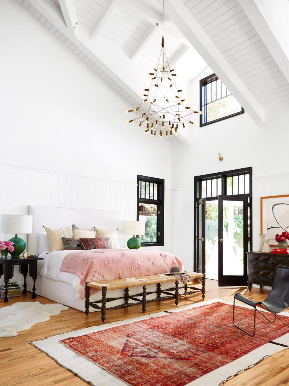 How to decorate around a bed: leave the walls blank! Let the architecture shine. // colorful bedroom, eclectic bedroom, pink bedroom, boho bedroom, bohemian eclectic bedroom