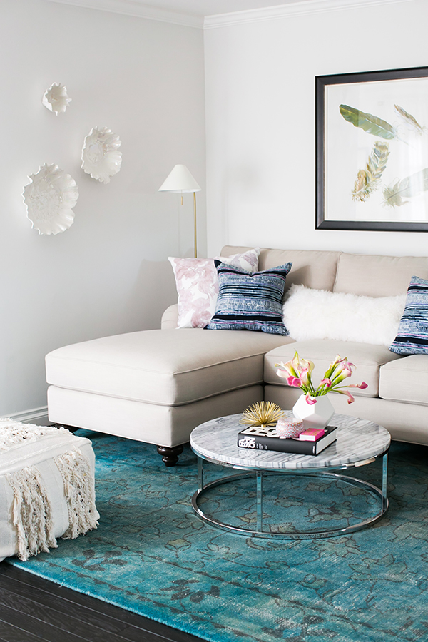 Get the look of this space on the blog! Neutral living room with overdyed teal rug.