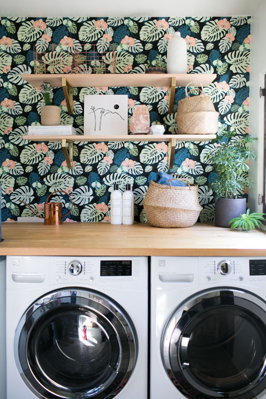 Botanical wallpaper in laundry room with butcher block countertop.