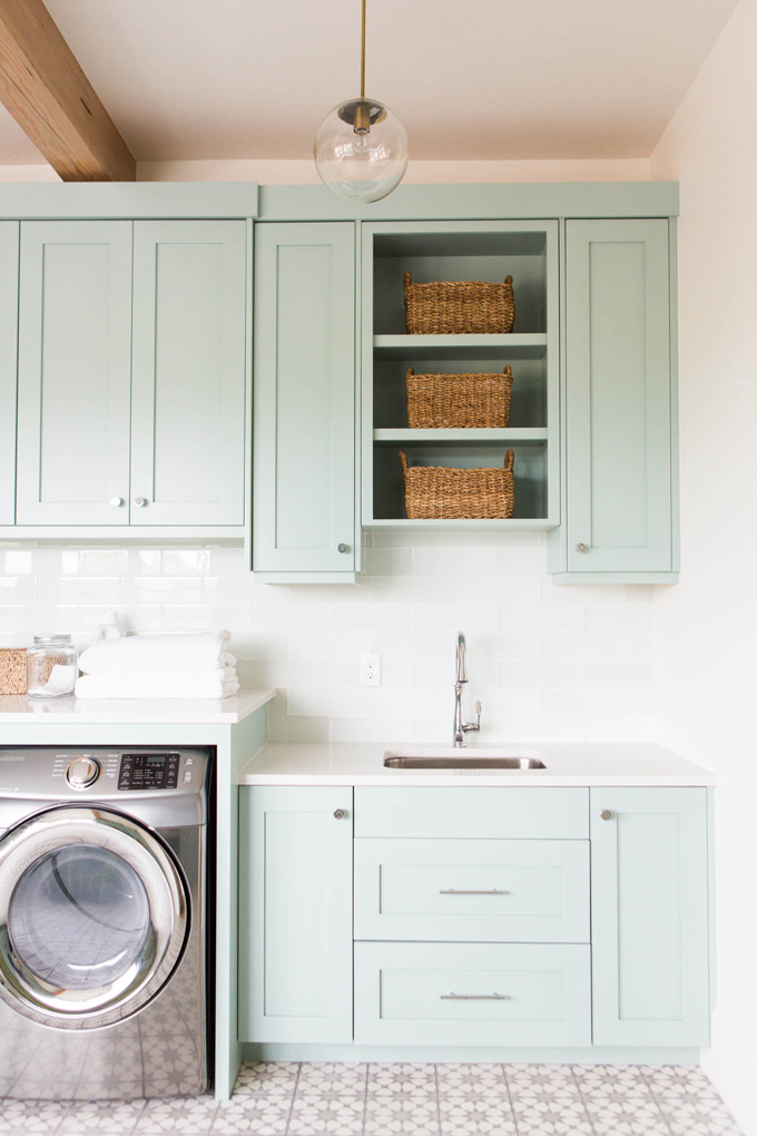 Aqua cabinets and star tile laundry room