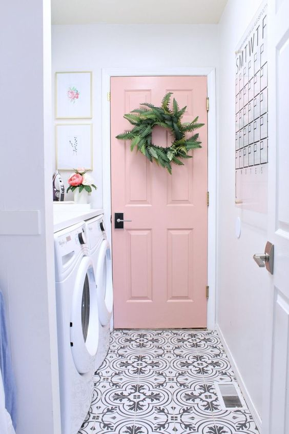 Pink door, cement tile in laundry room.