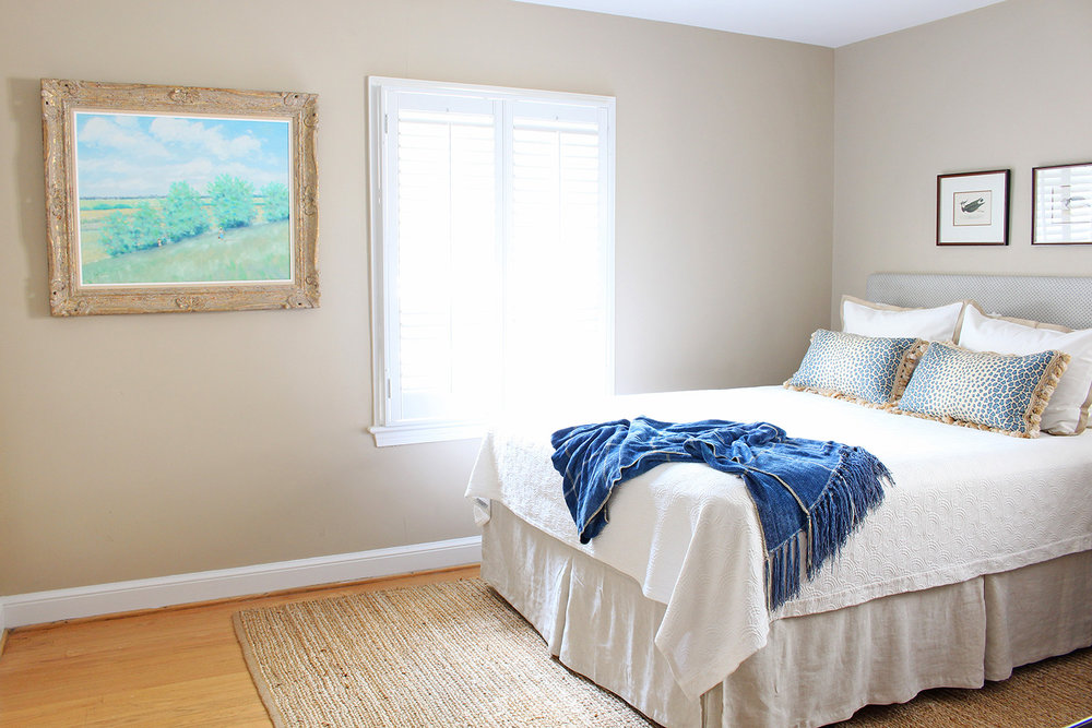 A traditional guest room gets a quick makeover with a small budget. // upholstered headboard, blue white beige bedroom
