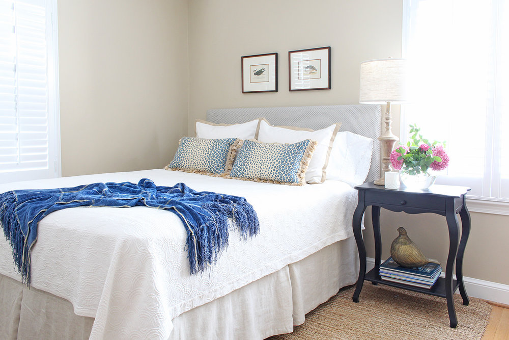 A traditional style bedroom gets a budget refresh and makeover with new linens, an upholstered headboard, and finds from around the house!
