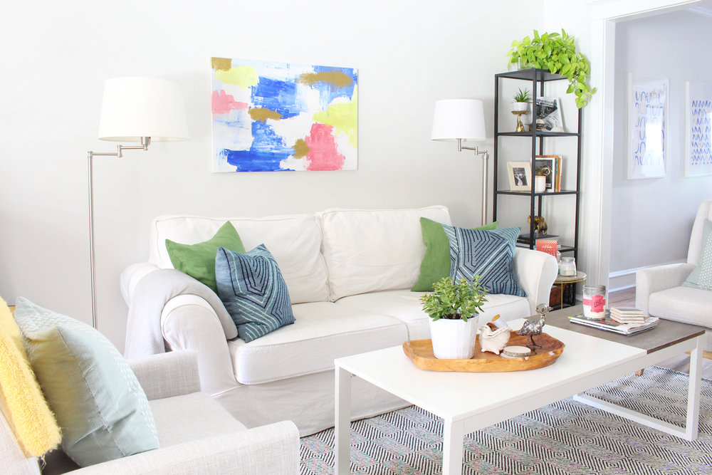 A bright, eclectic living room. // pottery barn sofa, white living room