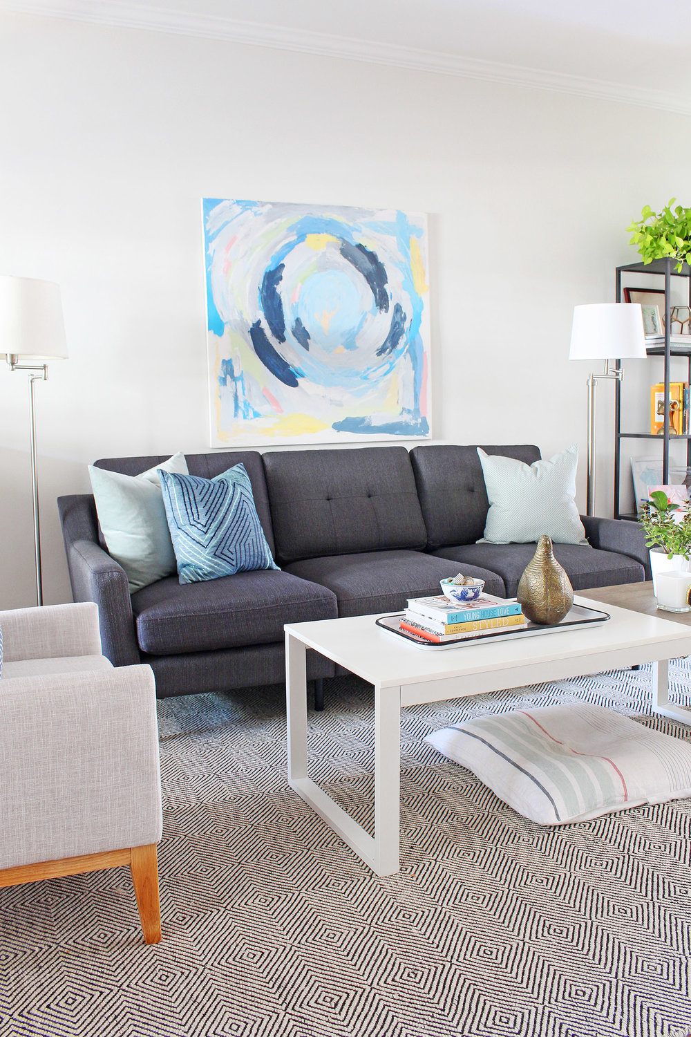 A new gray mid-century modern sofa updates the look of this living room. Head to Burrow.com to purchase your sofa and use code MIXANDMATCH to get $50 off of your purchase.