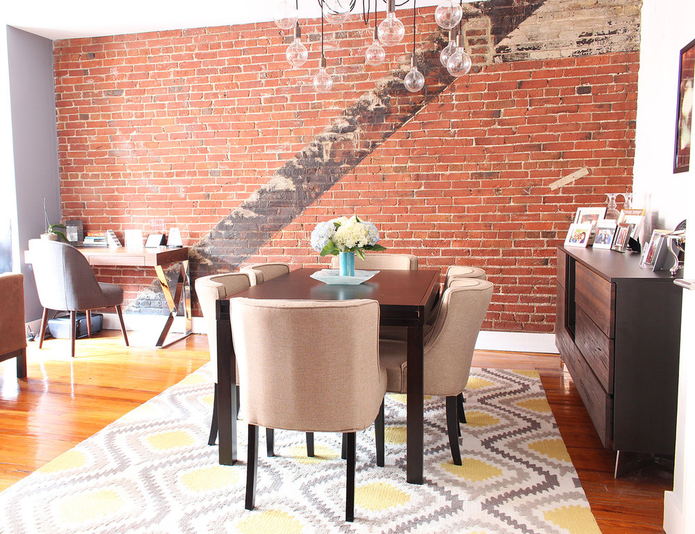 Contemporary meets classic in this converted textile factory condo's dining room/office in Philadelphia // contemporary dining room, transitional dining room, exposed brick