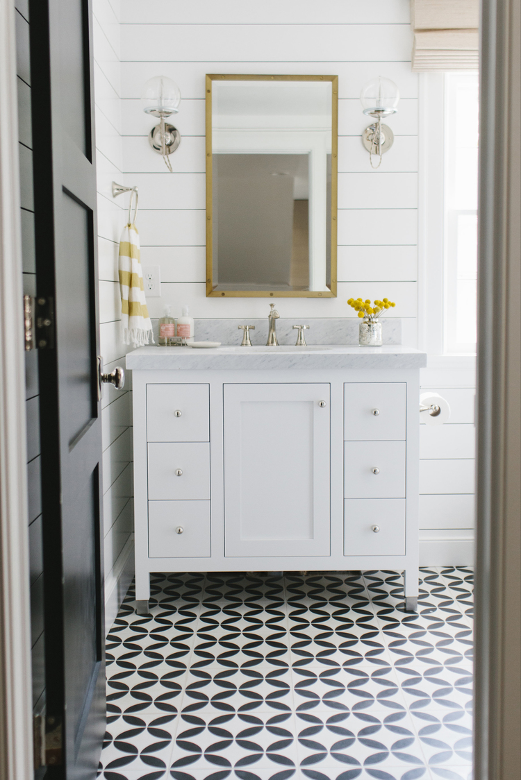 Shiplap in a powder room by Studio McGee // patterned floor tile, modern farmhouse bathroom