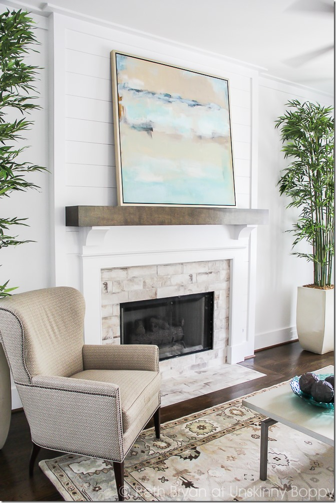 Shiplap fireplace surround, white shiplap, abstract art