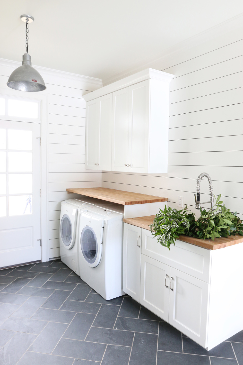 Laundry room with shiplap walls and herringbone tile floor // shiplap walls