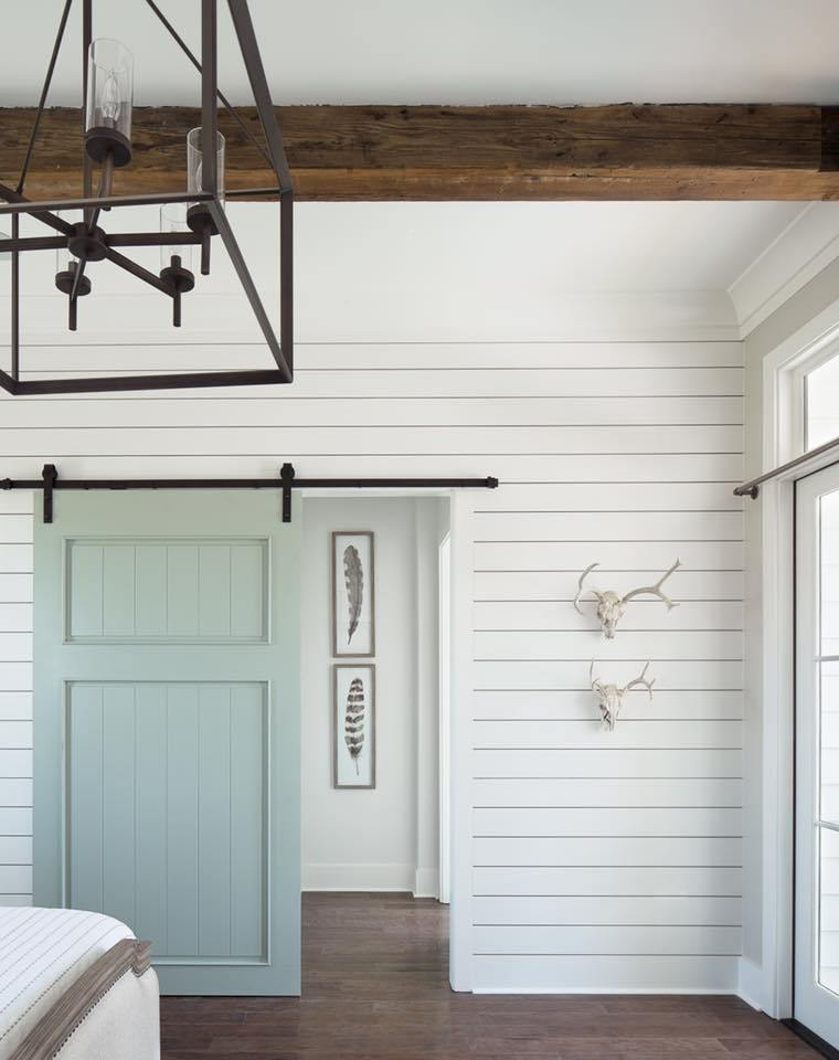 Shiplap wall in a bedroom with a barn door // aqua barn door // shiplap walls