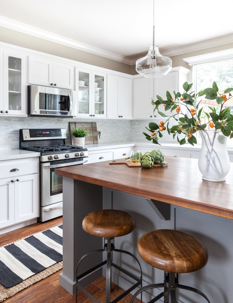Mix and match countertops in a kitchen. Butcher block and quartz countertops.