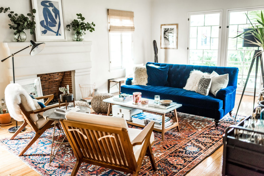 Mid-Century Eclectic living room from Devon Rachel | Persian Rug, blue sofa, mid-century chairs