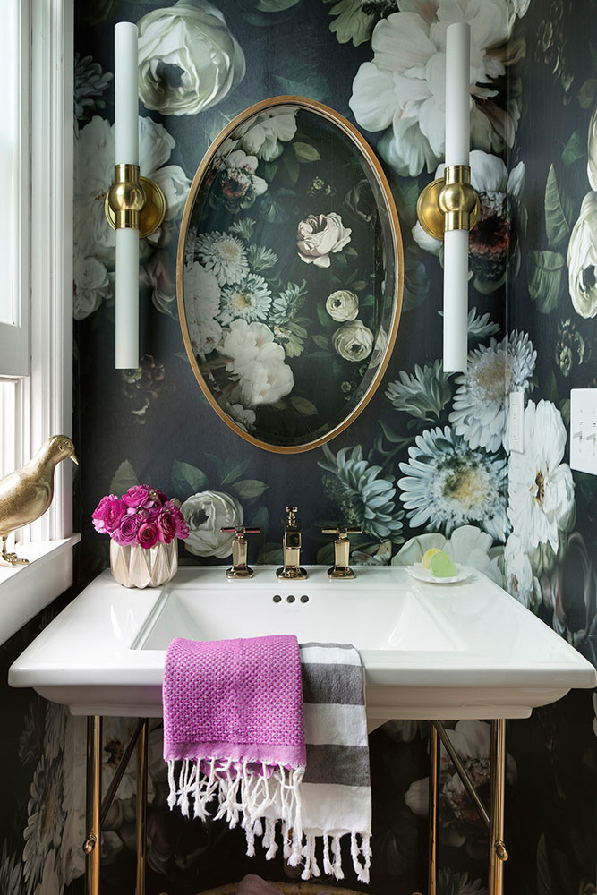 Beautiful floral wallpaper bathroom with brass accents from Lucy Interior Design
