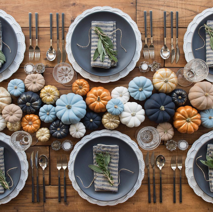 Non-traditional Thanksgiving tablescape with blues, golds, and oranges. Want more table decorating inspiration? Head to this post!