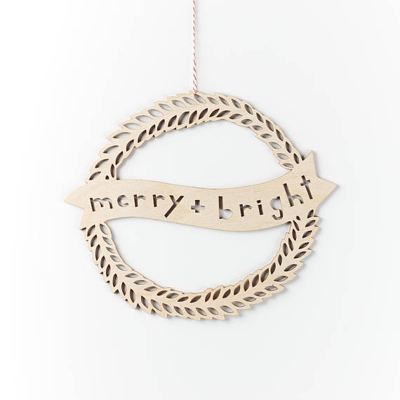 Shop small for Small Business Saturday! This post has a roundup of some of the best Etsy shops for home and decor. (Laser cut merry and bright wood wreath from Light & Paper)