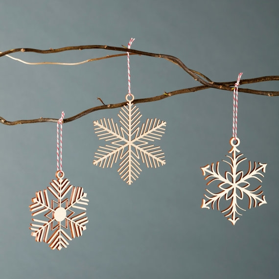 Shop small for Small Business Saturday! This post has a roundup of some of the best Etsy shops for home and decor. (Laser cut snowflake ornaments from Light & Paper)