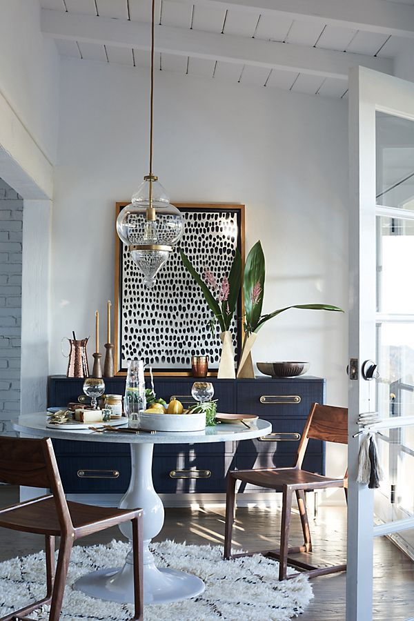 Get the look of this traditional meets eclectic dining room on the blog! / Glam dining room, round pedestal dining table, navy brass white dining room