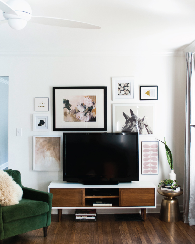 How to decorate around a TV: try a gallery wall! Come see all sorts of ideas and inspiration in this blog post!