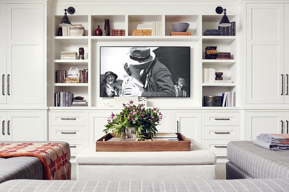 How to decorate around a TV. Distract from that big black box by adding beautifully styled bookshelves around it. Come see other ideas and inspiration in this blog post!