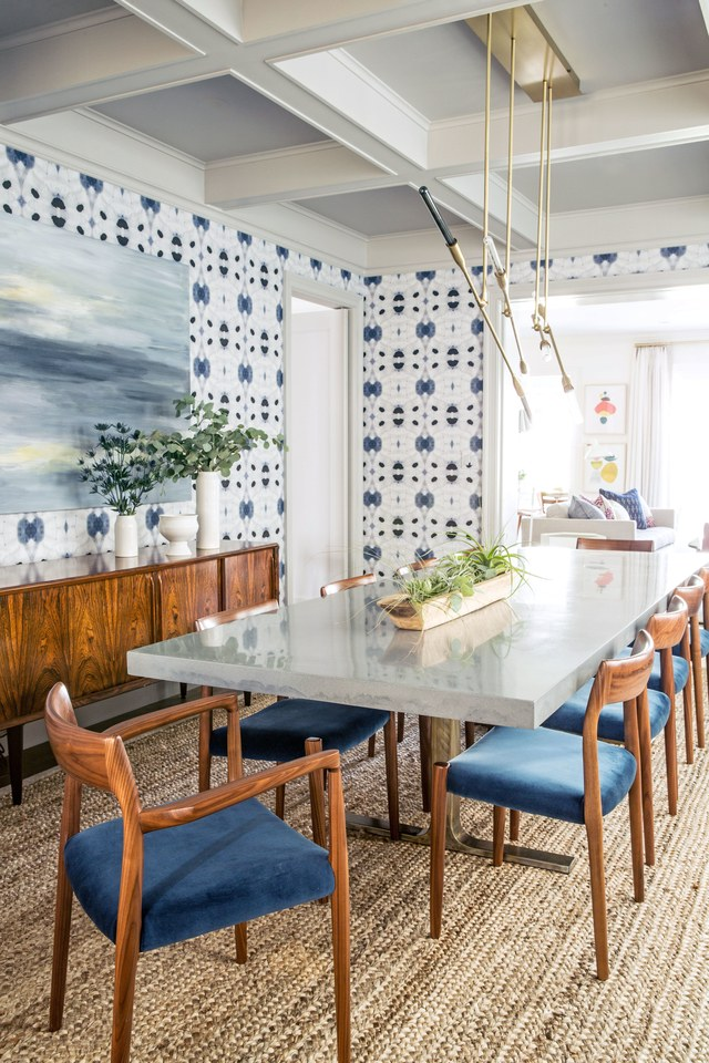 Get the look of this mid-century modern dining room on the blog! That indigo wallpaper is gorgeous, and complements the warm wood tones of the furniture beautifully.
