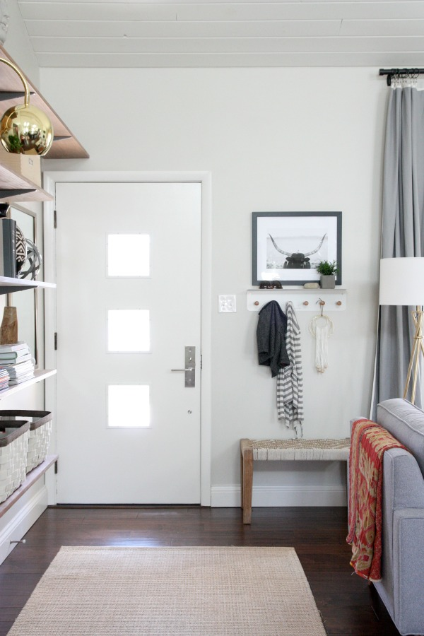 Add a bench and coats by the front door to create an entryway and drop zone. See more creative entryway ideas on the Mix & Match Design Company blog!