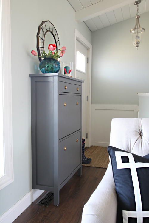 Add a shoe cabinet to create an entryway and drop zone. Make an entryway even if you don't have a true foyer. See more creative entryway ideas on the Mix & Match Design Company blog!